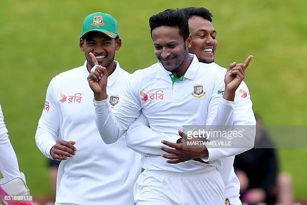 Bangladesh's Shakib Al Hasan celebrates New Zealand's Tom Latham being caught with LBW with team mates Kamrul Islam Rabbi R and Nazmul Hossain Shanto...