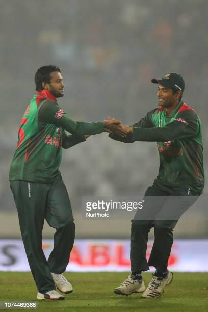 Bangladesh's Shakib Al Hasan celebrates with Mahmudullah Ruadh during the second T20 match between Bangladesh against West Indies in Mirpur Dhaka...