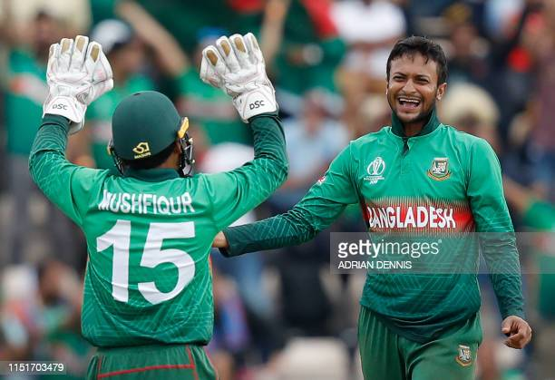 Bangladesh's Shakib Al Hasan celebrates with teammate Mushfiqur Rahim after the dismissal of Afghanistan's Najibullah Zadran during the 2019 Cricket...