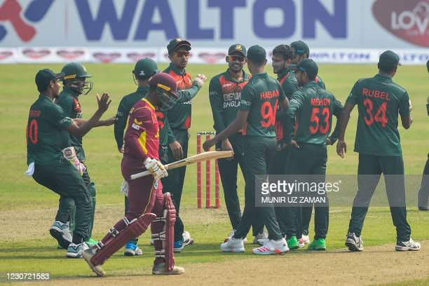 Bangladesh's Shakib Al Hasan celebrates with teammates after bowling out West Indies' Andre McCarthy during the second one-day international cricket...