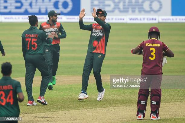 Bangladesh's Shakib Al Hasan celebrates with teammates after the dismissal of West Indies' Andre McCarthy during the first one-day international...