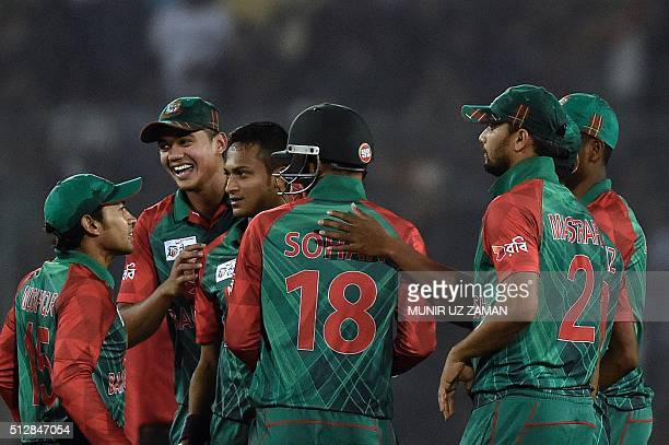 Bangladesh's Shakib Al Hasan celebrates with teammates after the dismissal of Sri Lanka's Shehan Jayasuriya during the Asia Cup T20 cricket...