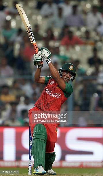 Bangladesh's Shakib Al Hasan plays a shot during the World T20 cricket tournament match between Pakistan and Bangladesh at The Eden Gardens Cricket...