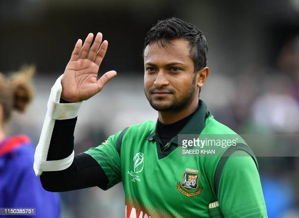 Bangladesh's Shakib Al Hasan waves to the fans as he walks off the pitch after winning the 2019 Cricket World Cup group stage match between West...