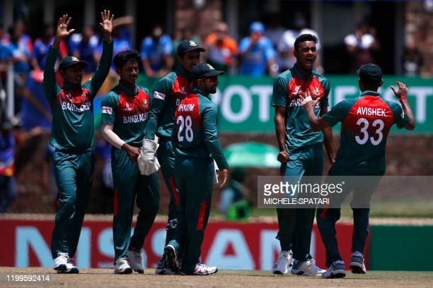 Bangladesh's Shoriful Islam celebrates with teammates after the dismissal of India's Siddhesh Veer during the ICC Under-19 World Cup cricket finals...