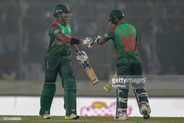 Bangladesh's Soumya Sarkar celebrate with Liton Das after hitting a boundary during the second ODI match between Bangladesh against West Indies in...