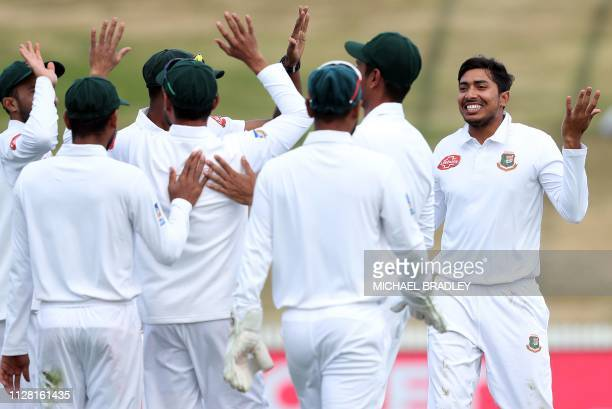 Bangladesh's Soumya Sarkar celebrates with teammates the wicket of New Zealand's Tom Latham during day two of the first cricket Test match between...