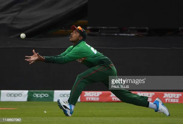 Bangladesh's Soumya Sarkar takes a catch to dismiss England's captain Eoin Morgan during the 2019 Cricket World Cup group stage match between England...