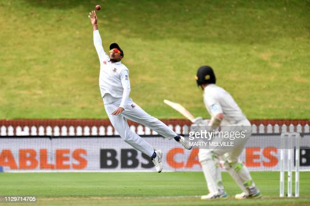 Bangladesh's Soumya Sarkar tries to take a catch of New Zealand's captain Kane Williamson during day four of the second cricket Test match between...
