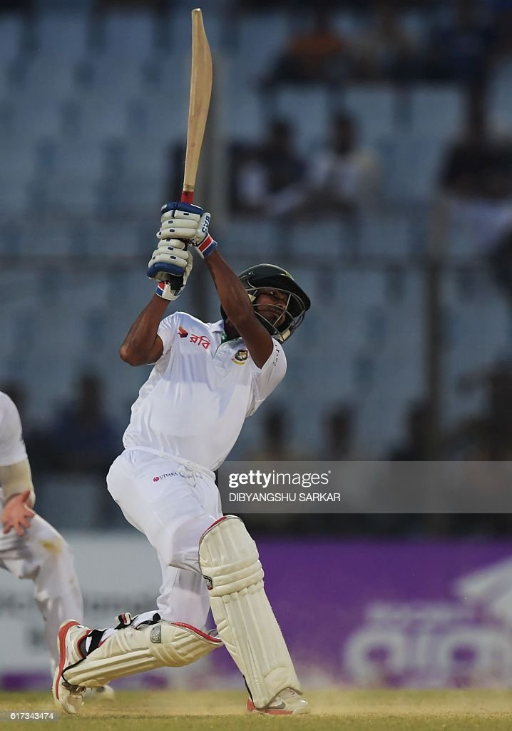 Bangladesh's Taijul Islam plays a shot during the fourth day's play of the first Test cricket match between Bangladesh and England at Zahur Ahmed Chowdhury Cricket Stadium in Chittagong on October 23, 2016. / AFP / Dibyangshu SARKAR