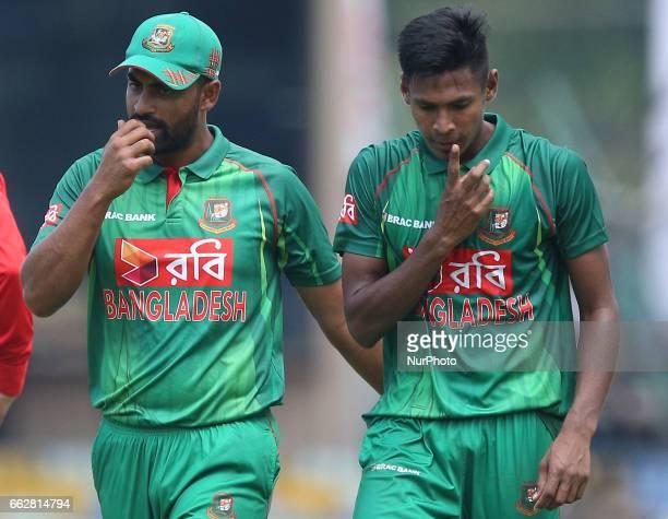 Bangladesh's Tamim Iqbal amp Mustafizur Rahman react after a discussion during the third oneday international cricket match between Sri Lanka amp...