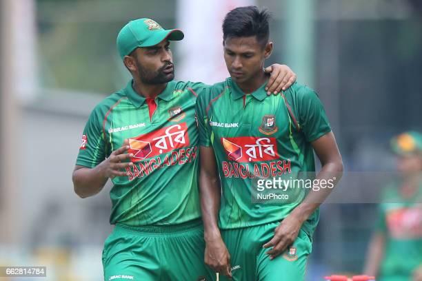 Bangladesh's Tamim Iqbal amp Mustafizur Rahman talks to eachother during the third oneday international cricket match between Sri Lanka amp...