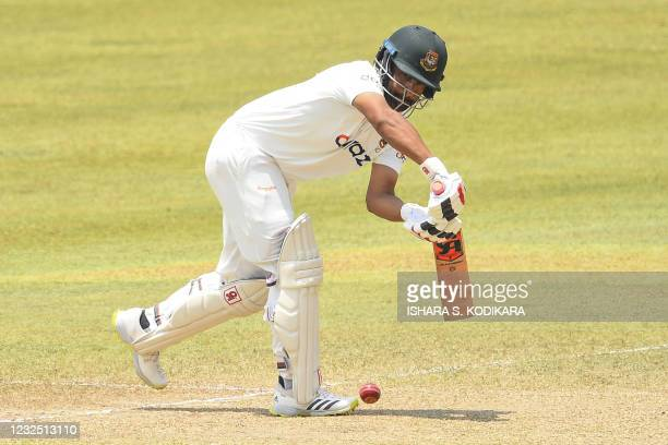 Bangladesh's Tamim Iqbal plays a shot during the fifth and final day of the first Test cricket match between Sri Lanka and Bangladesh at the...