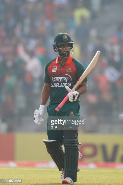 Bangladesh's Tamim Iqbal reacts after scoring a century during the second one day international cricket match between Bangladesh and Zimbabwe in...