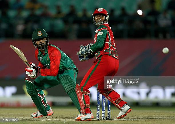 Bangladesh's Tammim Iqbal Khan tries to hit the ball during the qualifying match for the World T20 cricket tournament between Bangladesh and Oman at...