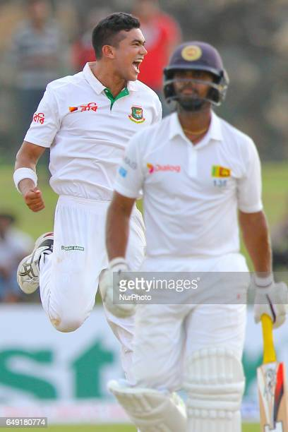 Bangladesh's Taskin Ahmed celebrates after he dismissed Sri Lanka's Asela Gunaratne during the first day of the opening Test cricket match between...