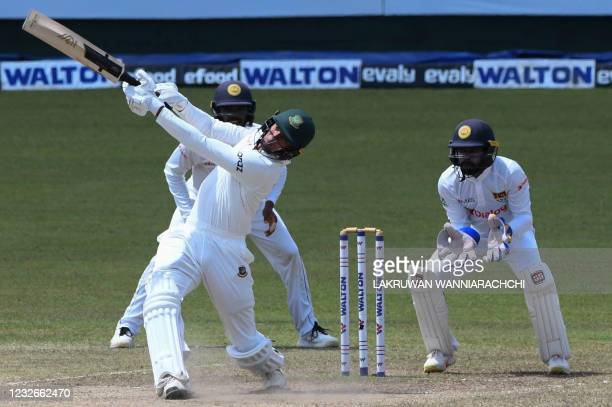 Bangladesh's Taskin Ahmed plays a shot as Sri Lanka's wicketkeeper Niroshan Dickwella and Dhananjaya de Silva look on during the final day of the...
