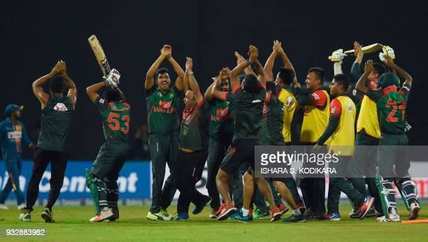 Bangladesh's team members perform a nagging dance as they celebrate their team's victory over Sri Lanka by 2 wickets during the sixth Twenty20...