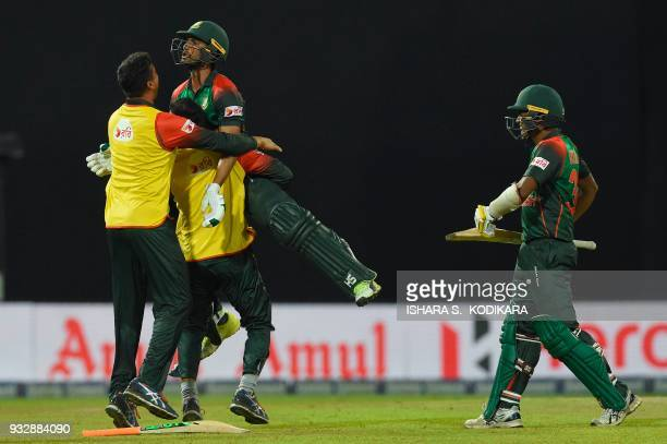 Bangladesh's team members their batsman Mahmudullah as they celebrate their team's victory over Sri Lanka by 2 wickets during the sixth Twenty20...