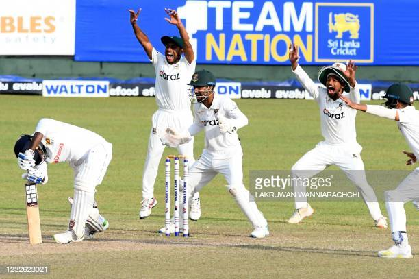 Bangladesh's wicketkeeper Liton Das and his teammates unsuccessfully appeal against the wicket of Sri Lanka's Angelo Mathews during the third day of...