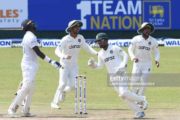Bangladesh's wicketkeeper Liton Das and teammates celebrate the dismissal of Sri Lanka's Angelo Mathews during the fourth day of the second and final...