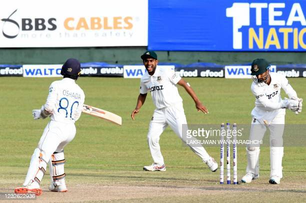 Bangladesh's wicketkeeper Liton Das is watched by teammate Mehidy Hasan Miraz as he stumps out Sri Lanka's Oshada Fernando during the third day of...