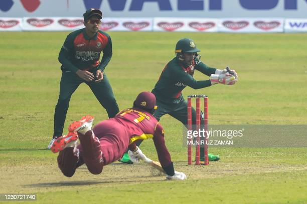 Bangladesh's wicketkeeper Mushfiqur Rahim catches the ball to break the wicket to run out West Indies' Kyle Mayers during the second one-day...
