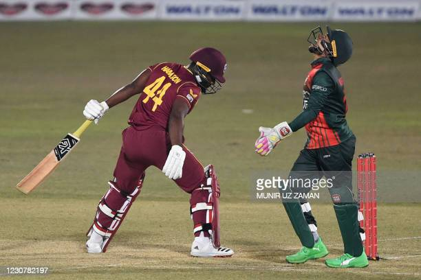 Bangladesh's wicketkeeper Mushfiqur Rahim celebrates after the dismissal of West Indies' Jahmar Hamilton during the third and final one-day...