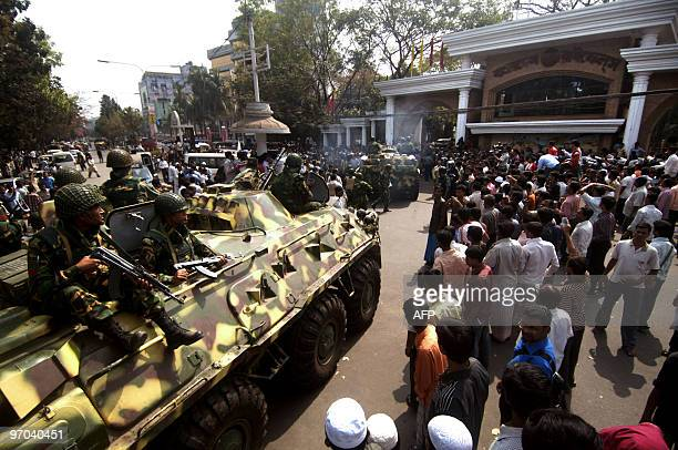 Bangladeshunresttrialsmutiny FOCUS by Cat Barton In this February 27 2009 file photograph Bangladeshi soldiers ride an armoured personnel carriers...