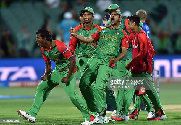 Banglandesh paceman Rubel Hossain and captain Mashrafe Mortaza celebrate the dismissal of England's batsman Eoin Morgan during the 2015 Cricket World...
