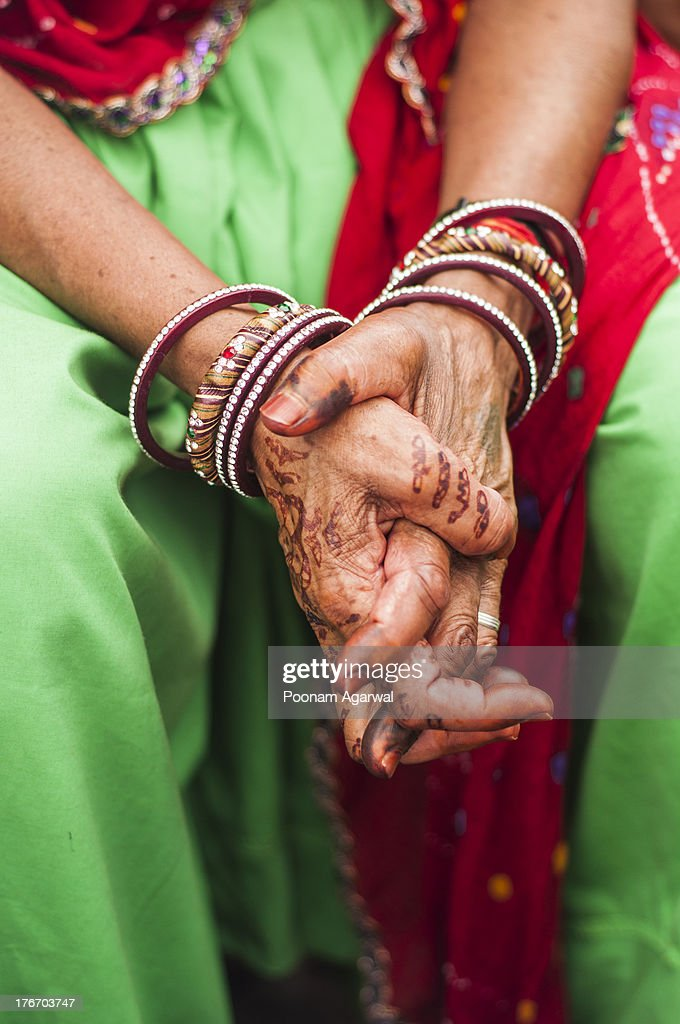 Bangles And Henna On Folded Hands Stock Photo | Getty Images