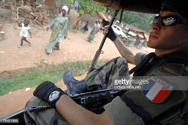 A French Legionaire of the Boali contingent sits in a mobile patrol 17 July 2007 in Bangui Central African Republic France presently has 400 troops...