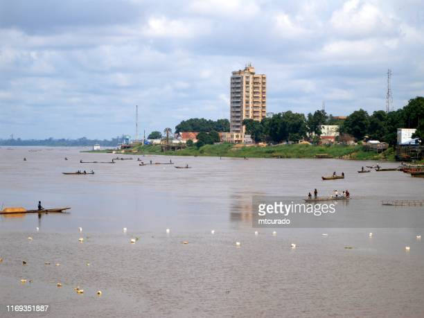 bangui cityscape along the right bank of the ubangui river - fishermen on canoes, central african republic - central african republic stock pictures, royalty-free photos & images