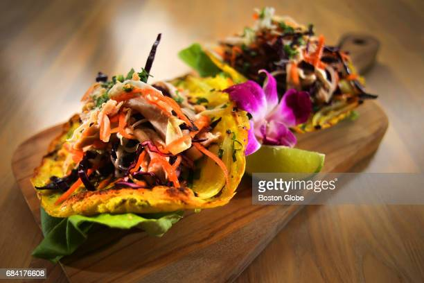 Banh xeo chicken salad tacos are pictured at District Kitchen in Malden MA on May 9 2017