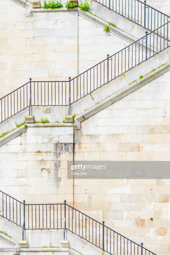 Banister and staircase on tall building : Foto stock