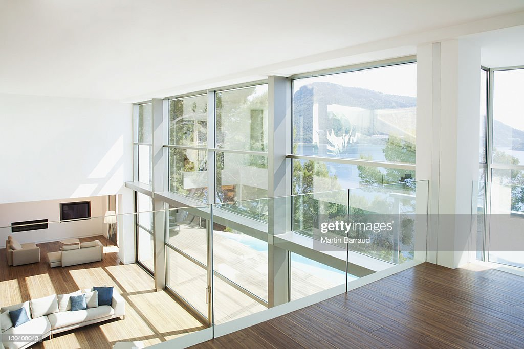 Banister overlooking modern living space : Stock Photo