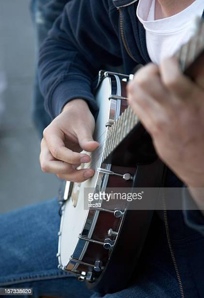 Banjo player hands close up