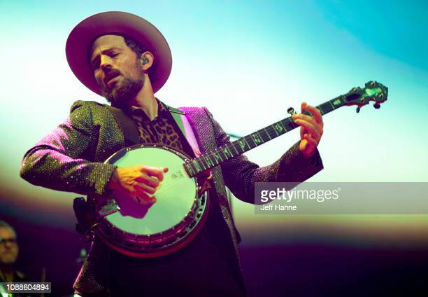 Banjo player/singer Scott Avett of the Avett Brothers performs at Bojangles Coliseum on December 31 2018 in Charlotte North Carolina