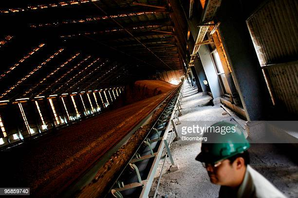Banjong Witayatawornwong production manager of Siam Cement Pcl checks a hangar containing raw materials at the company's cement factory in Kaeng Khoi...