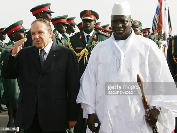 Gambian President Yahya Jammeh and Algerian President Abdelaziz Boutefilka review an honour guard 30 June 2006 upon his arrival at Banjul airport on...