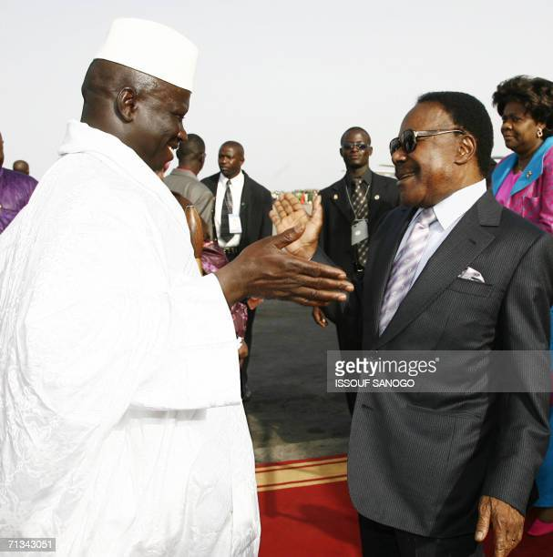 Gambian President Yahya Jammeh greets his Gabonese counterpart Omar Bongo, 30 June 2006 at Banjul airport on the eve of the bi-annual African Union...