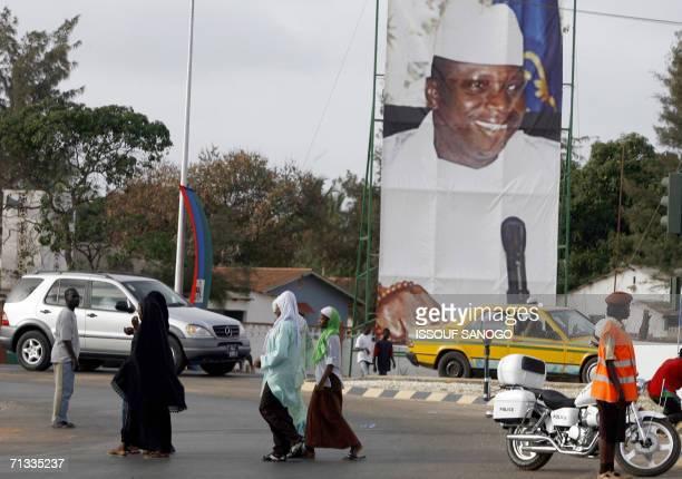 Giant portraits of Gambia President Yahya Jammeh and Libyan Guide Mohammar Khadafi decorate an avenue of the Gambian capital Banjul, 29 June 2006,...
