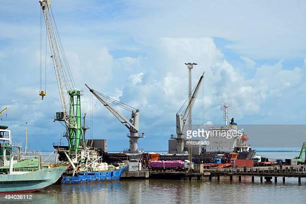 banjul port: unloading a bulk carrier freighter - banjul stock pictures, royalty-free photos & images