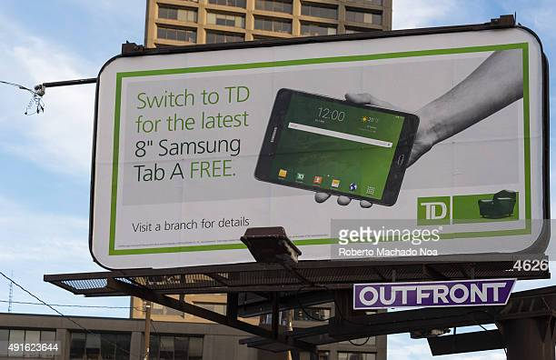 TD bank advertising technique offering personal electronic gadgets for business This advertisement board or sign board talks about switching to TD in...