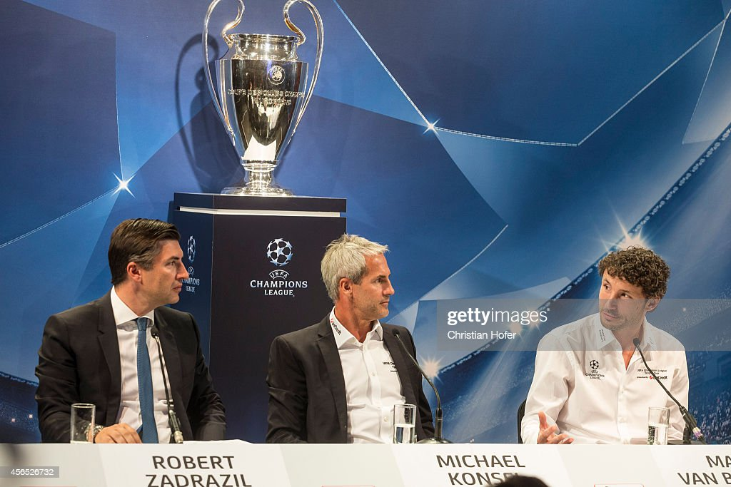 Bank Austria Board Member Robert Zadrazil, UEFA Ambassador Michael Konsel and UEFA Ambassador Mark van Bommel (L-R) attend the press conference prior to the Unicredit UEFA Champions League Trophy Tour on October 2, 2014 in Vienna, Austria.