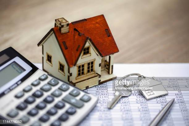 bank calculates the home loan rate - mortgage stock pictures, royalty-free photos & images