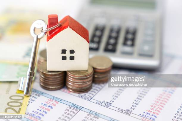 bank calculates the home loan rate,home insurance - housing difficulties stock pictures, royalty-free photos & images