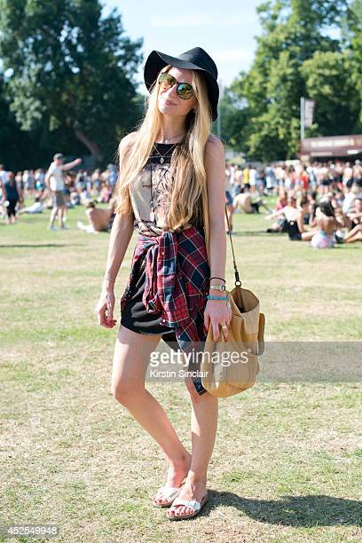 Bank clerk Bianca Fucita weraing a Zara shirt Birkenstock sandals and everything else by Tosphop at Lovebox 2014 on July 18 2014 in London England