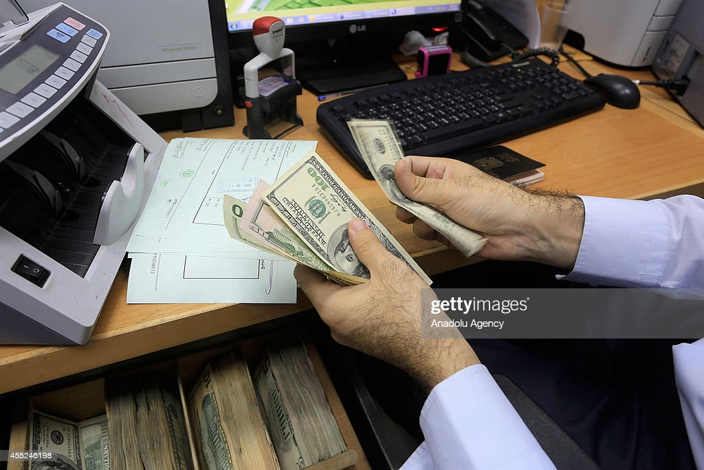 After months of delay government employees paid in Gaza : News Photo