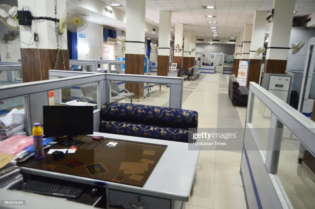 Bank counters are empty at one of the branches of the State Bank of India the country`s biggest bank as over a million employees of India`s...